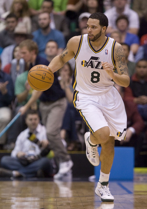 Jeremy Harmon  |  The Salt Lake Tribune Utah Jazz guard Deron Williams (8) brings the ball down court in the second half as the Jazz face the Phoenix Suns on Friday, February 11, 2011. Williams is being traded to the New Jersey Nets.