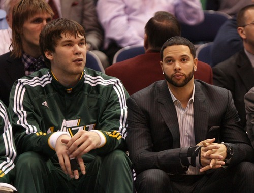 Steve Griffin  |  The Salt Lake Tribune A deal is in the works Wednesday for the Utah Jazz to trade all-star point guard Deron Williams, sitting here with Jazz center Kyrylo Fesenko, to the New Jersey Nets for two players, two draft picks and cash in a shocking NBA trade.