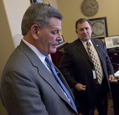 Al Hartmann   |  The Salt Lake Tribune  Utah Senate Majority Leader Scott Jenkins, left , and Senator Curtis Bramble  leave a press conference in which they unveiled a partial immigration omnibus bill Wednesday afternoon February 23.
