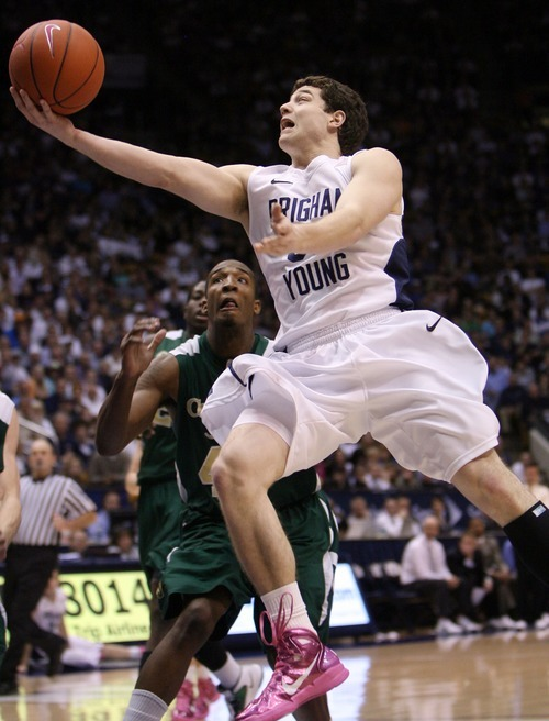 Steve Griffin  |  The Salt Lake Tribune   BYU's Jimmer Fredette scoops up a shot during first half action in the BYU versus CSU men's basketball game at the Marriott Center in Provo, Utah Wednesday, February 23, 2011.