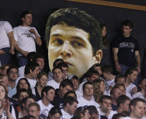 Steve Griffin  |  The Salt Lake Tribune   Fans hold up a giant Jimmer Fredette head  during first half action in the BYU versus CSU men's basketball game at the Marriott Center in Provo, Utah Wednesday, February 23, 2011.