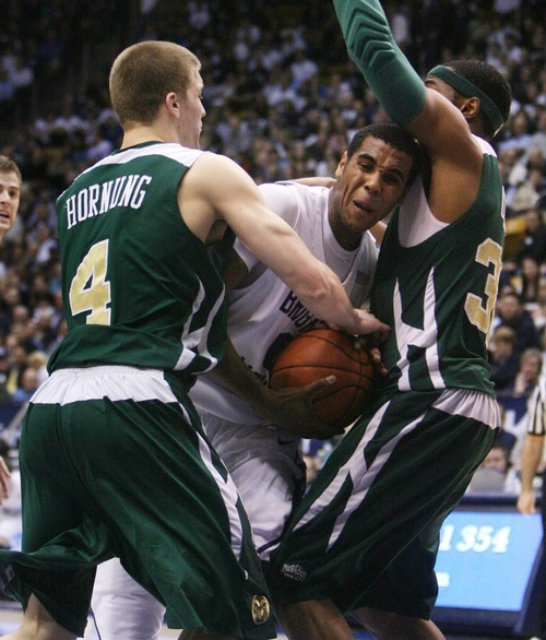 Steve Griffin  |  The Salt Lake Tribune   BYU's Brandon Davies tries to get through the CSU defense of Pierce Hornug and Andy Ogide during first half action in the BYU versus CSU men's basketball game at the Marriott Center in Provo, Utah Wednesday, February 23, 2011.