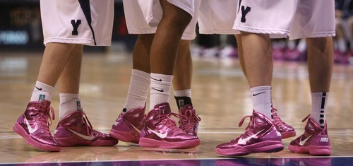 Steve Griffin  |  The Salt Lake Tribune   The Cougars huddle up in their pink shoes during first half action in the BYU versus CSU men's basketball game at the Marriott Center in Provo, Utah Wednesday, February 23, 2011. The Cougars wore the pink in support of Breast Cancer Awareness Month.