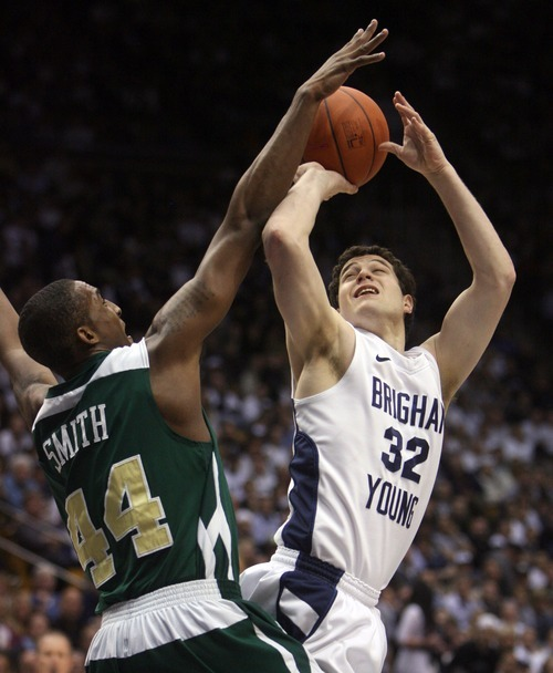 Steve Griffin  |  The Salt Lake Tribune   BYU's Jimmer Fredette turns as he shoots over CSU's Greg Smith during first half action in the BYU versus CSU men's basketball game at the Marriott Center in Provo, Utah Wednesday, February 23, 2011.