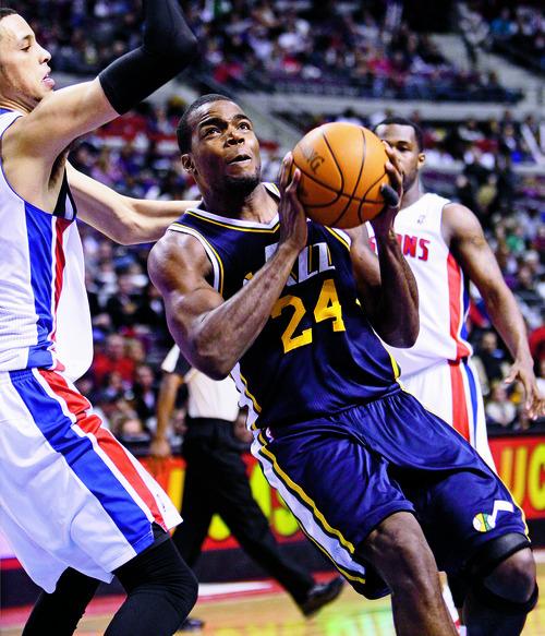 Utah Jazz forward Paul Millsap (24) drives against Detroit Pistons forward Austin Daye (5) in the second half of an NBA basketball game in Auburn Hills, Mich., Saturday, Feb. 26, 2011. Detroit won 120-116. (AP Photo/Paul Sancya)