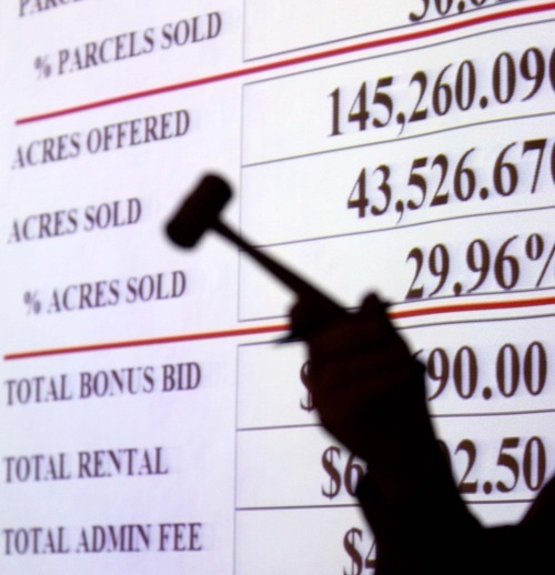 In this 2009 Tribune file photo, auctioneer Blaine Parker conducts an oil- and gas-lease sale at the Bureau of Land Management office.