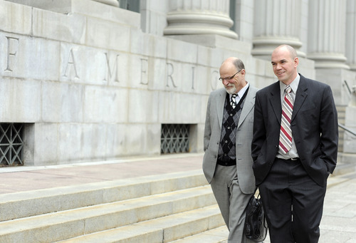 Sarah A. Miller  |  The Salt Lake Tribune  Tim DeChristopher, right, and attorney Ron Yengich leave federal court in Salt Lake City on Thursday, Feb. 25, 2011, after DeChristopher's pretrial hearing.