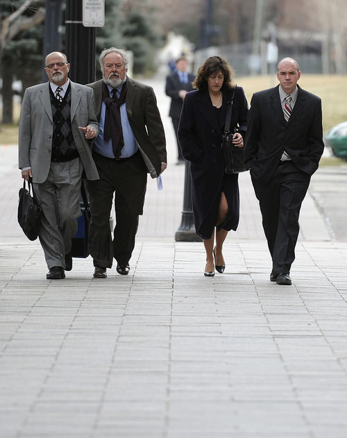Sarah A. Miller  |  The Salt Lake Tribune  Attorneys Ron Yengich, Pat Shea and Elizabeth Hunt walk with Tim DeChristopher, far right, as he arrives for his pretrial hearing in Federal Court in Salt Lake City on Thursday, Feb. 25, 2011.