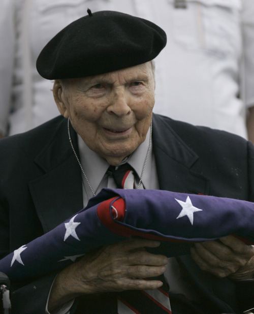 Charlie Riedel     Associated Press file photo  Frank Buckles receives an American flag during Memorial Day activities in 2008 at the National World War I Museum in Kansas City, Mo. Biographer and family spokesman David DeJonge said in a statement that Frank Woodruff Buckles died early Sunday of natural causes in his home in Charles Town, W.Va.
