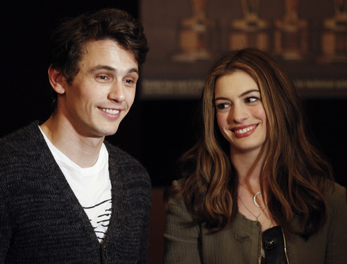 Actors James Franco, left, and Anne Hathaway talk to the media at the Kodak Theatre in the Hollywood section of Los Angeles, Thursday, Feb. 24, 2011. Franco and Hathaway are hosting 83rd Academy Awards, which airs Sunday. (AP Photo/Chris Carlson)