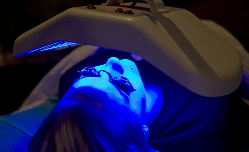Al Hartmann      The Salt Lake Tribune  Aesthetician student Sarah Olsen receives blue LED light therapy at the Cameo School of Essential Beauty in Murray.