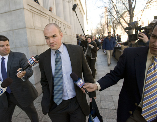 Al Hartmann   |  The Salt Lake Tribune  Tim DeChristopher leaves Frank Moss Federal Court in Salt Lake City on Tuesday after his first day of trial.   He made no comments to the media.