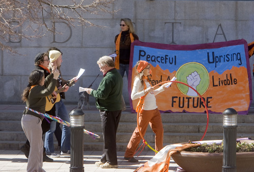Al Hartmann   |  The Salt Lake Tribune  Supporters of  Tim DeChristopher sing and rally on the steps of the Frank Moss Federal Court in Salt Lake City on Tuesday, March 1 for the first day of trial. The eco-activist,is on trial for disrupting an oil and gas lease auction.