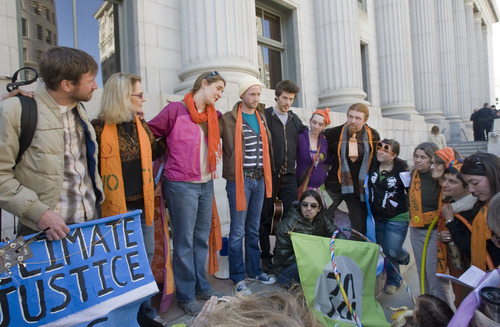 Al Hartmann   |  The Salt Lake Tribune  Supporters of  Tim DeChristopher huddle on the steps of the Frank Moss Federal Court in Salt Lake City on Tuesday, March 1 for the first day of trial. The eco-activist is on trial for disrupting an oil and gas lease auction.