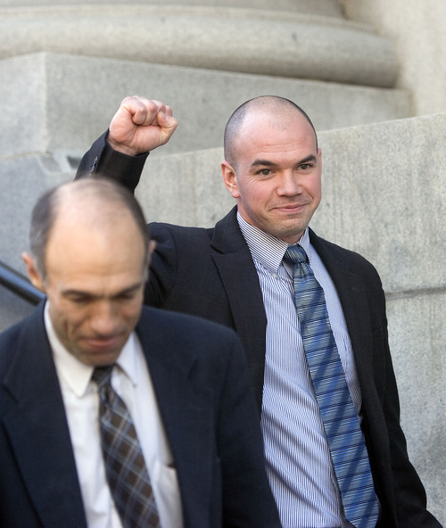 Al Hartmann   |  The Salt Lake Tribune  Tim DeChristopher pumps his fist to supporters as he leaves  Frank Moss Federal Court in Salt Lake City after his first day of trial on charges of disrupting an oil and gas lease auction in February.