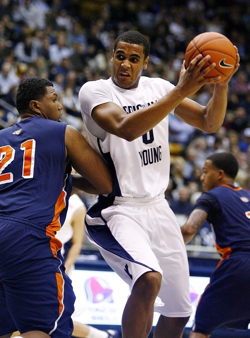 Djamila Grossman  |  The Salt Lake Tribune  Brigham Young University's Brandon Davies pushes past Fresno Pacific University's Kendall Holmes during a game Jan. 1, 2011.  Davies, who dismissed from the team on March 1 because of an honor code violation, plans to play next season.