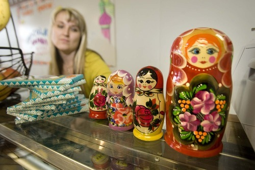 Paul Fraughton  |  The Salt Lake Tribune Irina Ermolaeva sets out a grouping of Russian nesting dolls at the Moscow Gourmet Food and Gifts in Draper. She is also a full-time nurse.