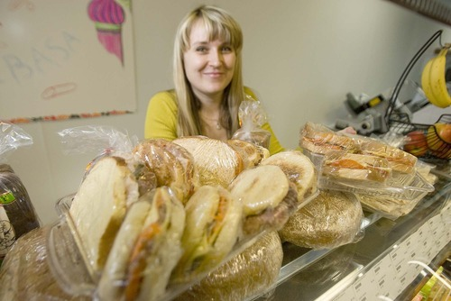 Paul Fraughton  |  The Salt Lake Tribune Irina Ermolaeva shows off a sampling of sandwiches made fresh at Moscow Gourmet Foods and Gifts, a new Draper market specializing in food and gifts imported from Russia and eastern Europe.
