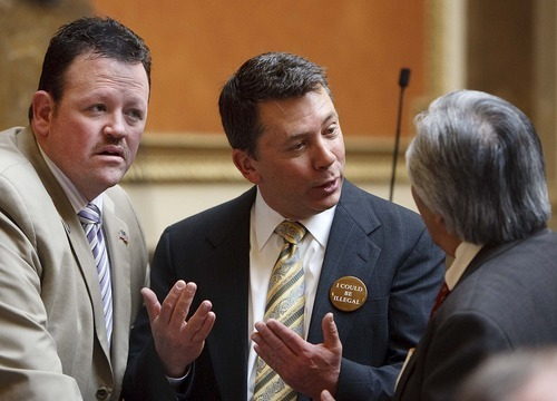 Trent Nelson  |  The Salt Lake Tribune Left to right, Rep. Carl Wimmer, Rep. Stephen Sandstrom, wearing a button reading,