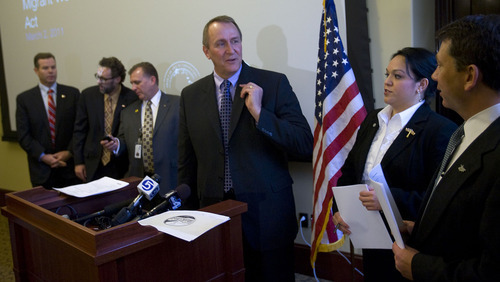 AL HARTMANN   |  The Salt Lake Tribune  Utah Attorney General Mark Shurtleff, center, joins with Sen. Luz Robles and Rep. Stephen Sandstrom in support of a new guest worker bill. The proposal would establish a partnership between Utah and the Mexican state of Nuevo Leon.