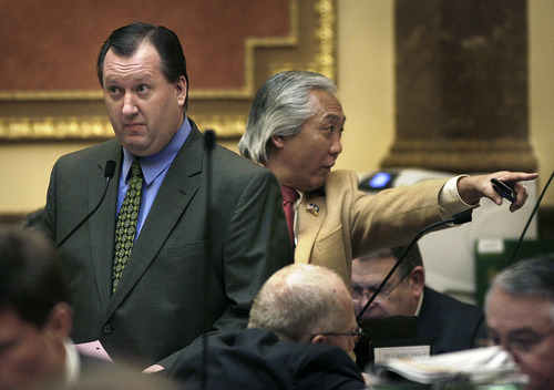 SCOTT SOMMERDORF  |  The Salt Lake Tribune Rep. John Dougall, R-Highland, speaks on the floor as fellow Rep. Curt Oda, R-Clearfield, talks with another Representative in the Utah House of Representatives on Thursday. After a 15-minute debate and only one day after it was publicly released, Dougall's HB477, making major amendments to the state open records law, passed the House.