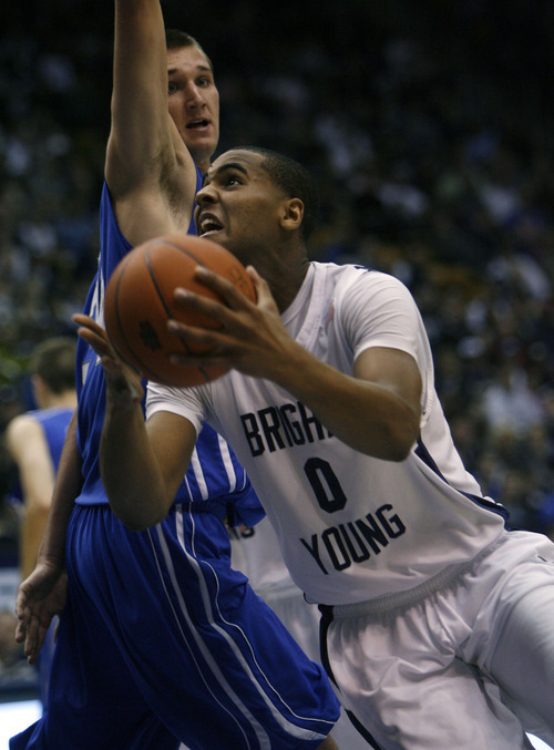 Francisco Kjolseth     The Salt Lake Tribune Brandon Davies of BYU pushes past Air Force in men's basketball for the Cougars conference home opener. The starting center has been dismissed from BYU's basketball team for violating the school's honor code.