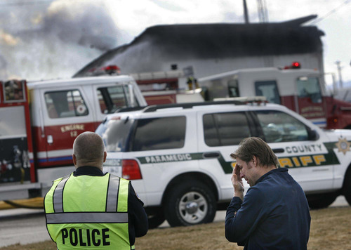 Scott Sommerdorf  |  The Salt Lake Tribune Gary Clark, co-owner and chemical engineer at Clear Sky Biofuels in Clearfield, speaks to a police officer about fire Friday that destroyed his business and an adjoining auto-repair shop.