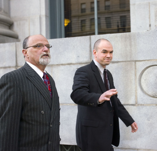 Al Hartmann      The Salt Lake Tribune  Tim DeChristopher, right,  enters Frank Moss Federal Courthouse in Salt Lake City on Thursday, March 3 with his lawyer Ron Yengich.