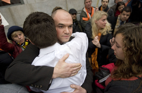 Al Hartmann      The Salt Lake Tribune  Tim DeChristopher wades though his supporters giving hugs and thanks after being found guilty of crashing a federal oil and gas lease auction outside the Frank Moss Federal Courthouse in Salt Lake City March 3.