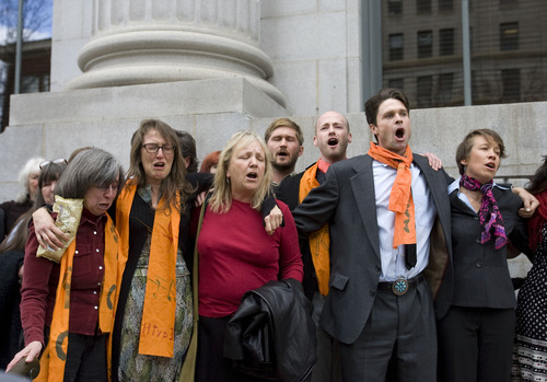 Al Hartmann   |  The Salt Lake Tribune  Tim DeChristopher supporters sing and get emotional after being found guilty of crashing a federal oil and gas lease auction outside the Frank Moss Federal Courthouse in Salt Lake City March 3.