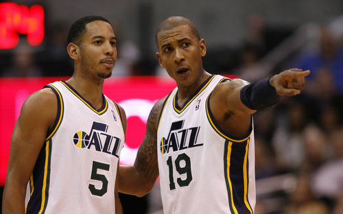 Rick Egan   |  The Salt Lake Tribune Utah Jazz guard Devin Harris gets instructions from Utah Jazz guard Raja Bell in a home game in February against Boston. The Jazz lost 107-102 before a sell-out crowd after committing defensive lapses down the stretch.