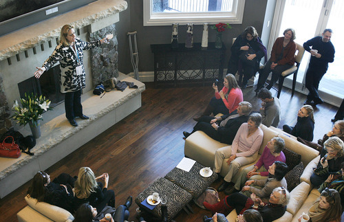 Scott Sommerdorf  l  The Salt Lake Tribune Geralyn Dreyfous (far left) climbed up on the hearth to speak to roughly 100 guests in Jacki Zehner's home in Park Meadows on Jan. 23, where she met one more time with Gloria Steinem, Geena Davis and other women connected to the movie industry.