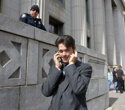 Al Hartmann      The Salt Lake Tribune  Ryan Pleune, a supporter of Tim DeChristopher, talks on phone and waits outside the Frank Moss Federal Courthouse on Thursday afternoon waiting for a verdict from the jury. He was fired from the Salt Lake School District for taking a detour with his school bus earlier in the week to show students the peaceful protesters at the courthouse.