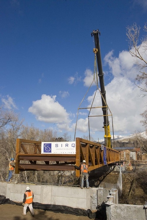 Paul Fraughton  |  The Salt Lake Tribune  The largest mobile crane in the state carefully eases a  70,000-pound bridge over Emigration  Creek at Hogle Zoo in Salt Lake City on  Friday, March 4, 2011. The new bridge is part of the zoo's Rocky Shores exhibit, which will feature polar bears, sea lions, seals and more when it opens in about a year.