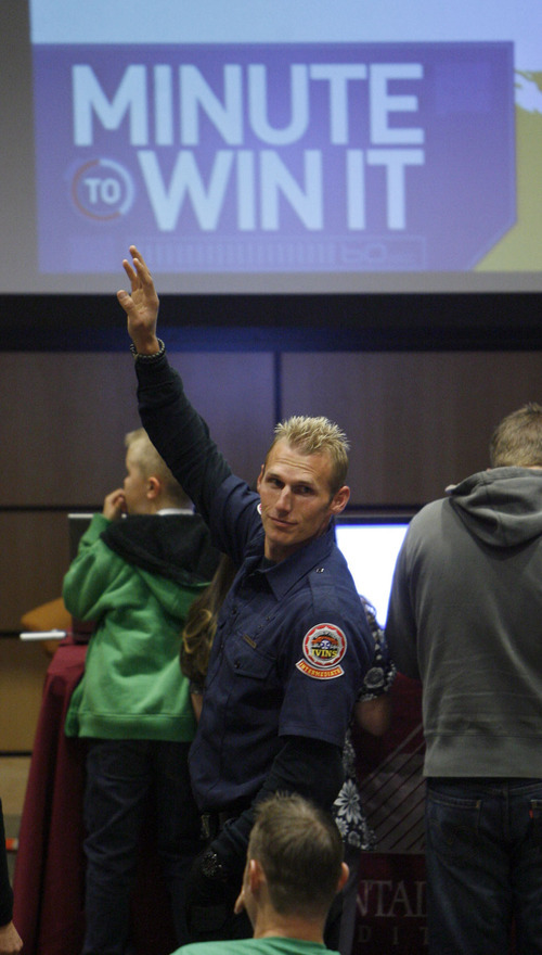 Francisco Kjolseth  |  The Salt Lake Tribune Rick Pitcher a volunteer firefighter from St. George raises his hand as the question is asked,