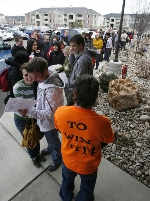 Francisco Kjolseth  |  The Salt Lake Tribune Cortnee Crockett and Todd Furmess, from left, of Sandy and Patrick Zook of Preston Idaho wearing his T-shirt made by his wife stand in the long line for tryouts at a chance to win 1-million. The game show Minute to Win It held the tryouts in West Jordan on Saturday, March 5, 2011, where hundreds showed up at a chance to appear on the popular game show hosted by Guy Fieri.