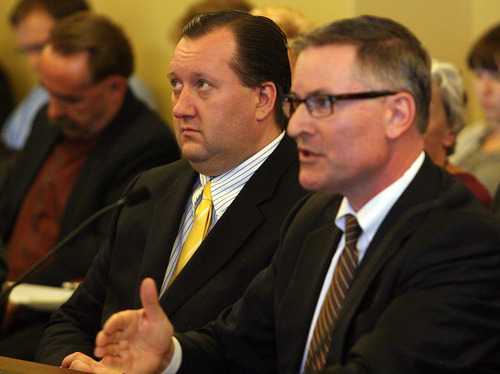 Leah Hogsten  |  The Salt Lake Tribune Rep. John Dougall, left, listens as Jeff Hunt, an attorney with Utah Media Coalition, gives his dissenting remarkson Dougall's HB477, which would substantially rewrite Utah's open-records law.