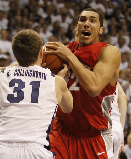 Rick Egan  |  The Salt Lake Tribune  BYU guard Kyle Collinsworth (31) grabs the ball from Drew Gordon (32) New Mexico, in Mountain West Basketball action, BYU vs New Mexico in the Marriott Center in Provo, Wednesday, March 2, 2011