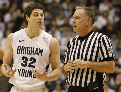 Djamila Grossman | The Salt Lake   BYU guard Jimmer Fredette (32) has a chat with the ref, in Mountain West Basketball action, BYU vs New Mexico in the Marriott Center in Provo, Wednesday, March 2, 2011