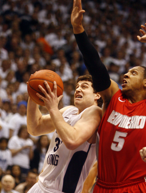 Djamila Grossman   The Salt Lake   BYU guard Jimmer Fredette (32) takes the ball inside as New Mexico guard Dairese Gary (5) defends, Mountain West Basketball action at the Marriott Center in Provo, Wednesday, March 2, 2011