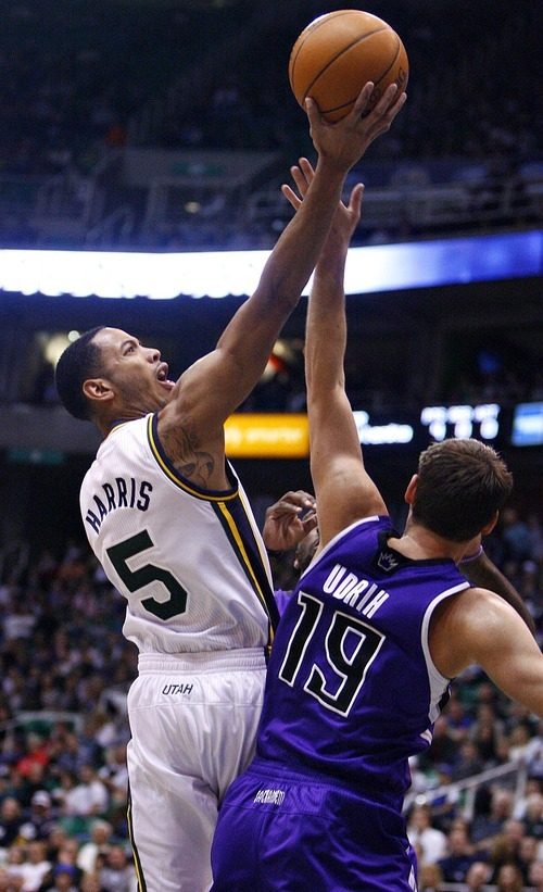 Djamila Grossman  |  The Salt Lake Tribune  The Utah Jazz' Devin Harris (5) jumps up to score as the Sacramento Kings' Beno Udrih (19) tries to block the shot during a game at Energy Solutions Arena in Salt Lake City, Utah, on Saturday, March 5, 2011.