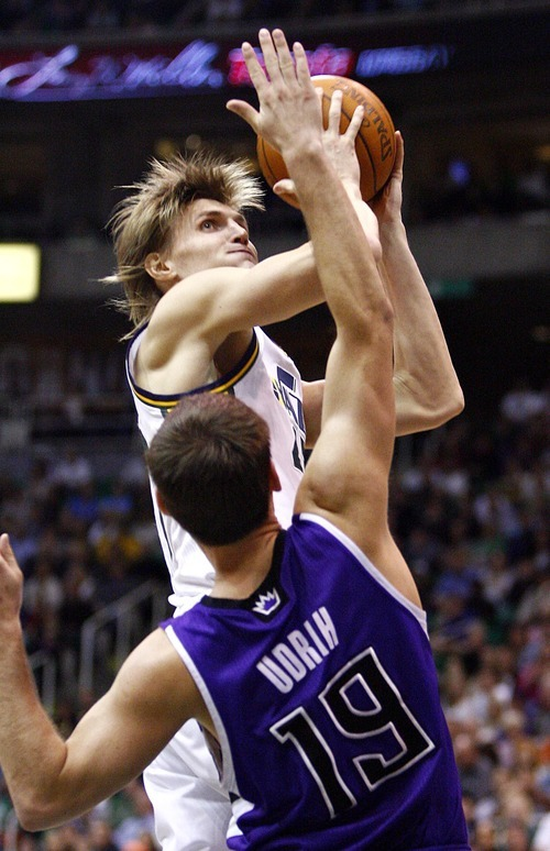 Djamila Grossman  |  The Salt Lake Tribune  The Utah Jazz' Andrei Kirilenko gets blocked by the Sacramento Kings' Beno Udrih (19) during a game at Energy Solutions Arena in Salt Lake City, Utah, on Saturday, March 5, 2011. The Jazz won the game.