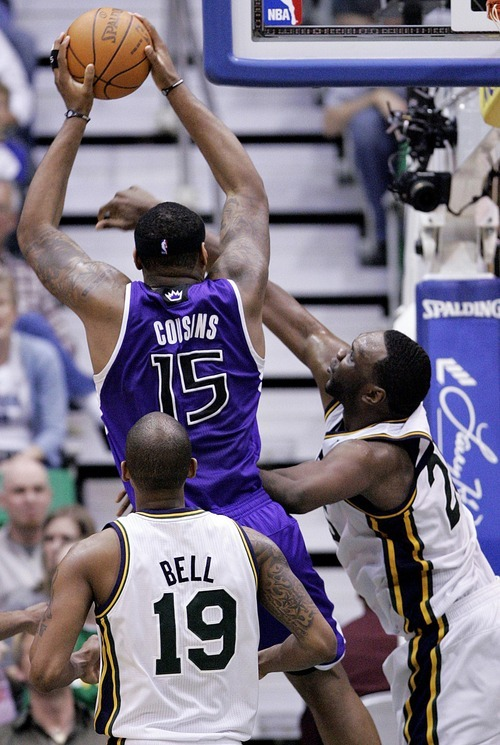 Djamila Grossman  |  The Salt Lake Tribune  The Utah Jazz' Al Jefferson (25) and Raja Bell (19) block a shot by the Sacramento Kings' DeMarcus Cousins (15) during a game at Energy Solutions Arena in Salt Lake City, Utah, on Saturday, March 5, 2011. The Jazz won the game.