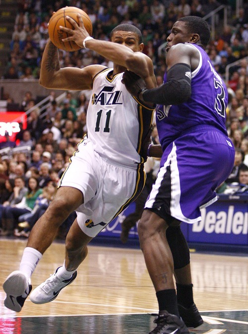 Djamila Grossman  |  The Salt Lake Tribune  The Utah Jazz' Earl Watson (11) drives past the Sacramento Kings' Jermaine Taylor (3) during a game at Energy Solutions Arena in Salt Lake City, Utah, on Saturday, March 5, 2011. The Jazz won the game.