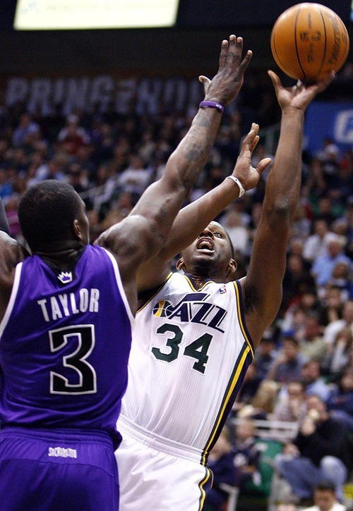 Djamila Grossman  |  The Salt Lake Tribune  The Utah Jazz' C.J. Miles (34) shoots past the Sacramento Kings' Jermaine Taylor (3) during a game at Energy Solutions Arena in Salt Lake City, Utah, on Saturday, March 5, 2011. The Jazz won the game.