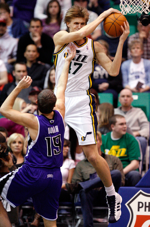 Utah Jazz forward Andrei Kirilenko (47), of Russia, comes away with a rebound aainst Sacramento Kings guard Beno Udrih (19), of Sempeter, Slovenia during the first half of their NBA basketball game in Salt Lake City, Saturday, March 5, 2011. (AP Photo/Steve C. Wilson)