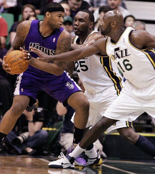 Djamila Grossman  |  The Salt Lake Tribune  The Sacramento Kings' DeMarcus Cousins (15), defends the ball against the Utah Jazz' Al Jefferson (25) and Francisco Elson (16) during a game at Energy Solutions Arena in Salt Lake City, Utah, on Saturday, March 5, 2011.