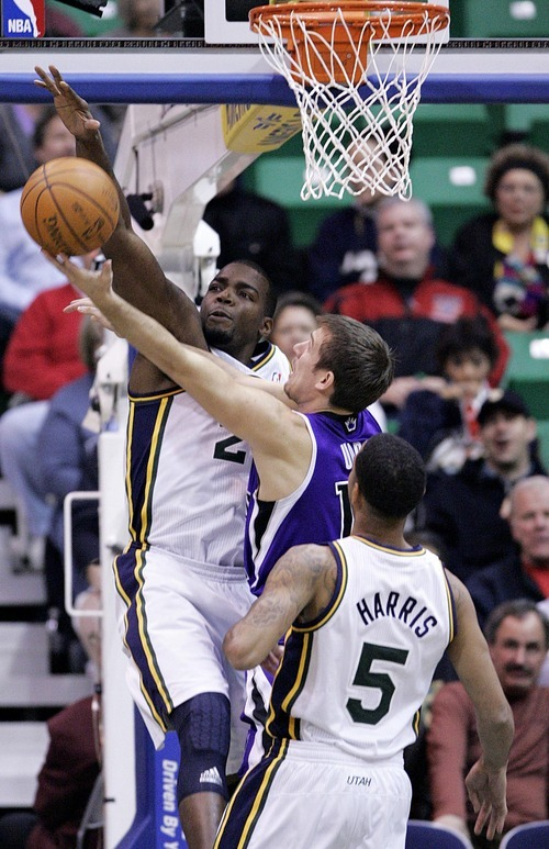 Djamila Grossman  |  The Salt Lake Tribune  The Utah Jazz' Paul Millsap (24) and Devin Harris (5) block a shot by the Sacramento Kings' Beno Udrih (19) during a game at Energy Solutions Arena in Salt Lake City, Utah, on Saturday, March 5, 2011. The Jazz won the game.