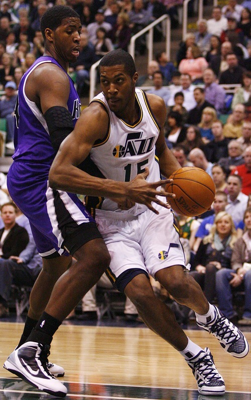 Djamila Grossman  |  The Salt Lake Tribune  The Utah Jazz' Derrick Favors (15) drives past the Sacramento Kings' Jason Thompson (34) during a game at Energy Solutions Arena in Salt Lake City, Utah, on Saturday, March 5, 2011. The Jazz won the game.