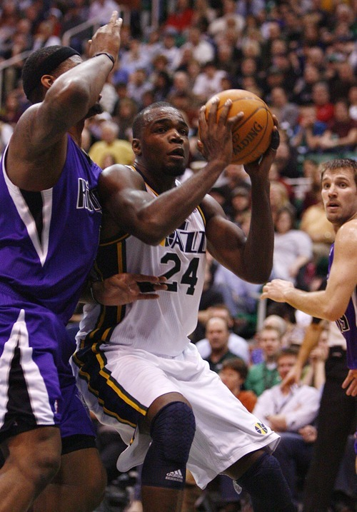 Djamila Grossman  |  The Salt Lake Tribune  The Utah Jazz' Paul Millsap (24) drives past the Sacramento Kings' DeMarcus Cousins (15) during a game at Energy Solutions Arena in Salt Lake City, Utah, on Saturday, March 5, 2011. The Jazz won the game.